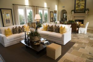 Furnished living room with throw pillows on couch in Gilbert AZ
