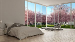 Minimalist design bedroom with large window looking at cherry tree blossoms