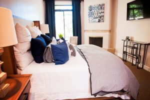 Furnished bedroom with throw pillows on bed, Design to Reflect, Gilbert AZ