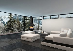 Furnished living room with large window looking at snow covered trees